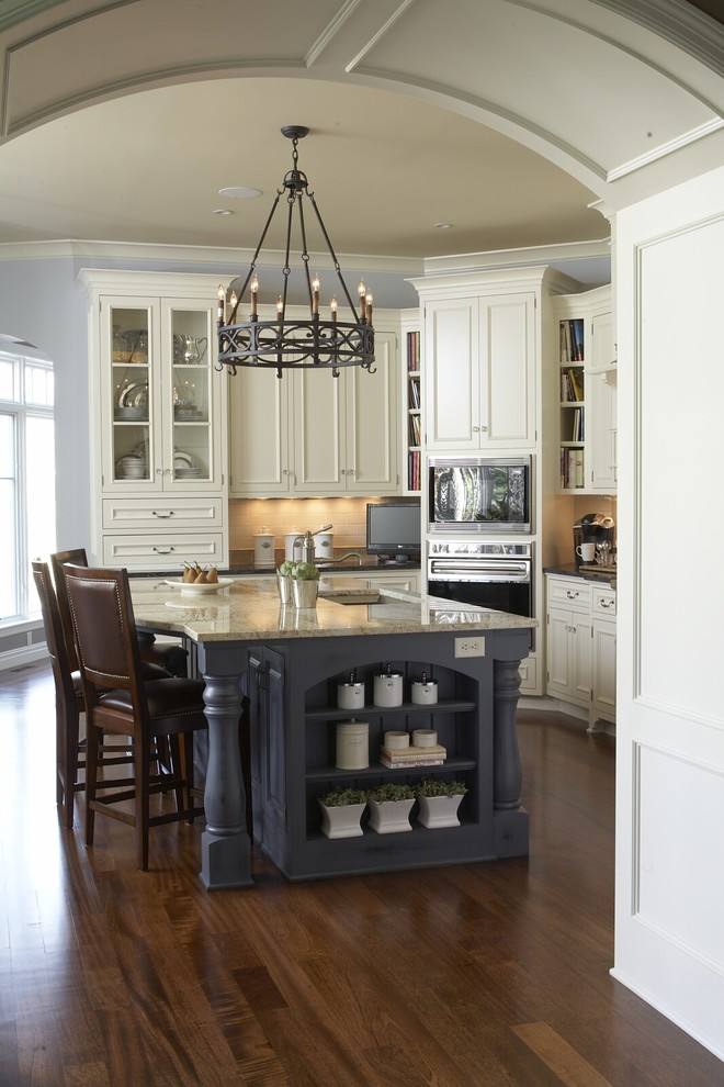 country kitchen paint color beautiful brown floor wall cabinets island shelves chairs chandelier books traditional kitchen