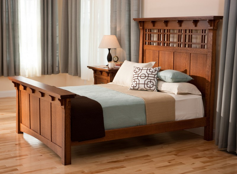 craftsman bedroom design dark hardwood bed frame with higher headboard multicolored bed linen light toned and gloss wood floors