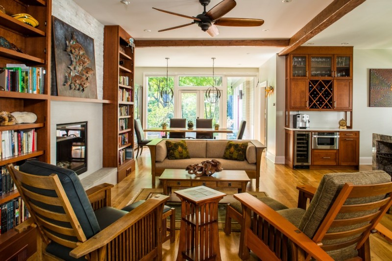 craftsman open concept living room design with medium toned hardwood floors craftsman furniture craftsman book shelves craftsman wine storage