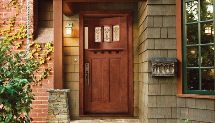 craftsman style front door stone floor bricks window decorative plants lamp rustic entry