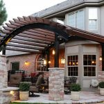 Curved Pergola With Black Painted Pillars And Red Bricks Bases