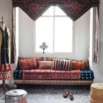 daybed for living room cushion pouffe rugs drapes double windows mannequin mediterranean design