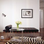 daybed for living room sidetable standing lamp zebra carpet hardwood floors glass vase painting white walls modern design