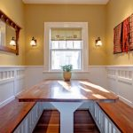 Dining Booth For Home Benches Wood Top Table Hardwood Floors Yellow Wall Decorative Mirror Decorations Light Fixtures Traditional Design