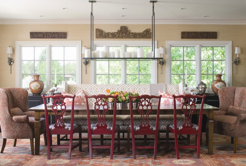 dining room table with bench and chairs flowers lamps windows traditional style