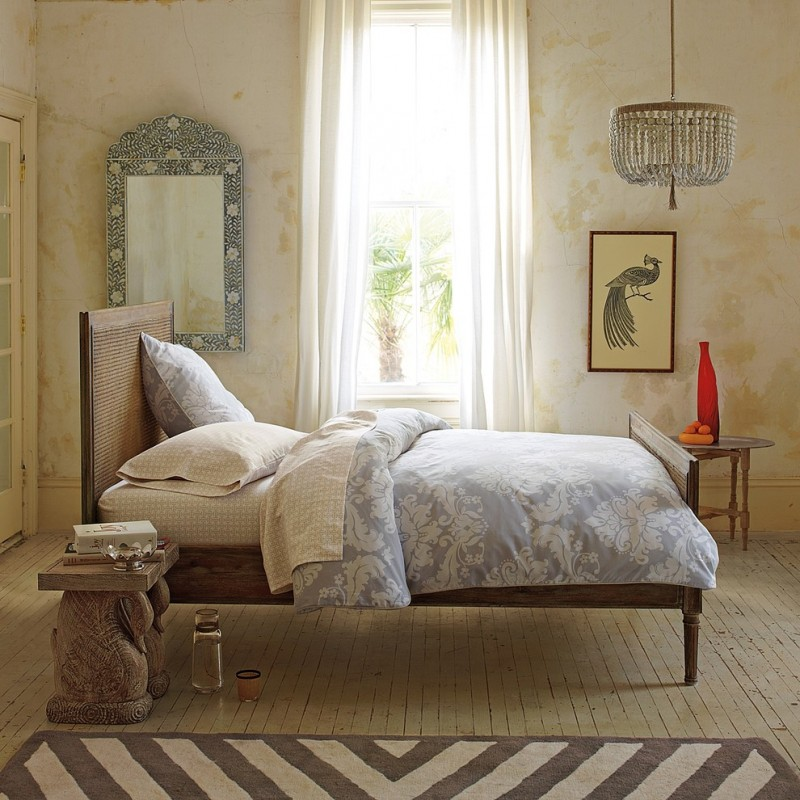 duvet with damask motifs classic wood bed frame with headboard classic style framed mirror chic shabby woodboard floors shabby walls handmade bird painting monochromatic stripes area rug