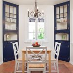 Enclosed Mediterranean Dining Room With A Couple Of Blue Navy Corner Cabinets White Dining Chairs Wooden Dining Table Without Finishing Terracotta Floors Centered Window