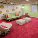 Exposed Ceiling Pink Rug Floral Accent Green Wall Green Sofa White Chair Pink Pillow TV