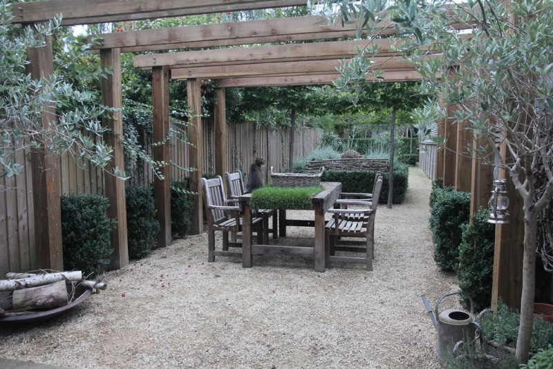 farmhouse backyard patio with wooden pergola wooden furniture for patio gravel floors