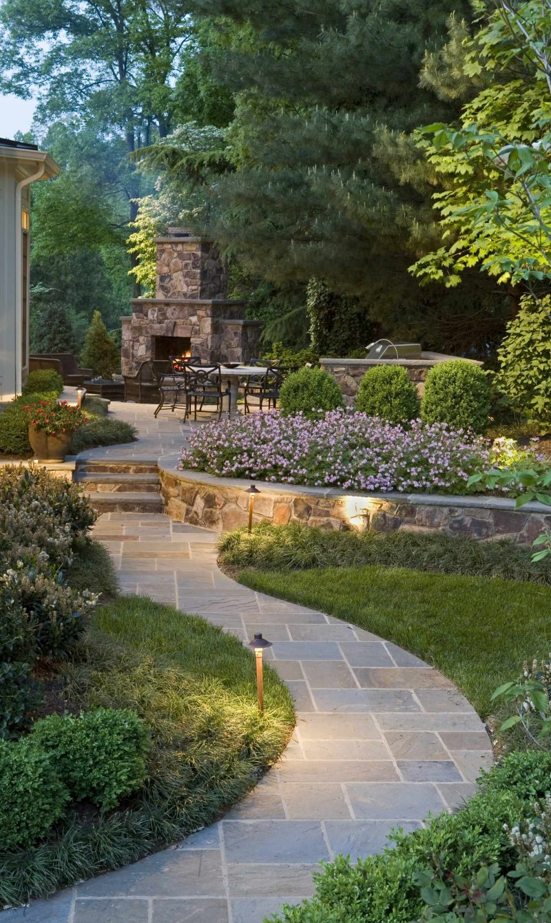 flagstone pathway grass trees outdoor dining space barbecue space stone fireplace garden flowers