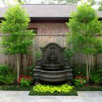 Front Yard Fountain Garden Trees Wood Fence Stone Pavers Plants Traditional Design