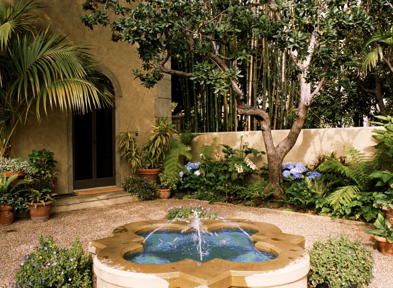 front yard fountains flower pots doube doors pavers walls plants mediterranean design