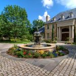 front yard fountains garden stone pavers windows limestone walls roofs metal fence pillars traditional design