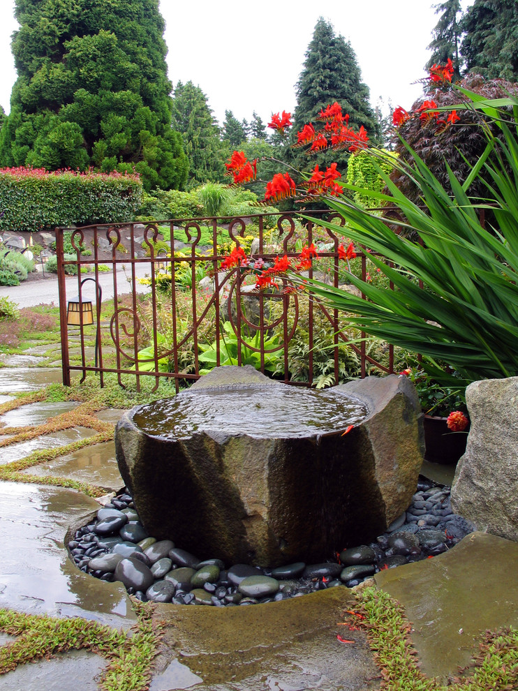 front yard fountains stone pavers peebles metal fence flowers contemporary design