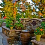 front yard fountains urn peebles pond stone pavers walls plant pots mediterranean design