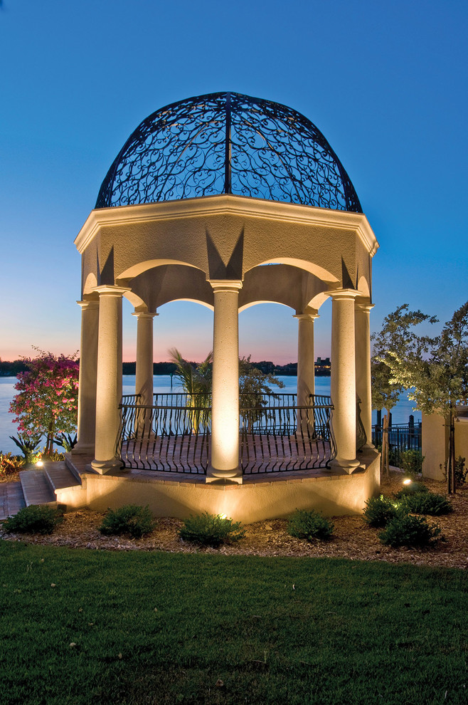 gazebo with beautiful steel ceiling, lights on the ground illuminate the gazebo