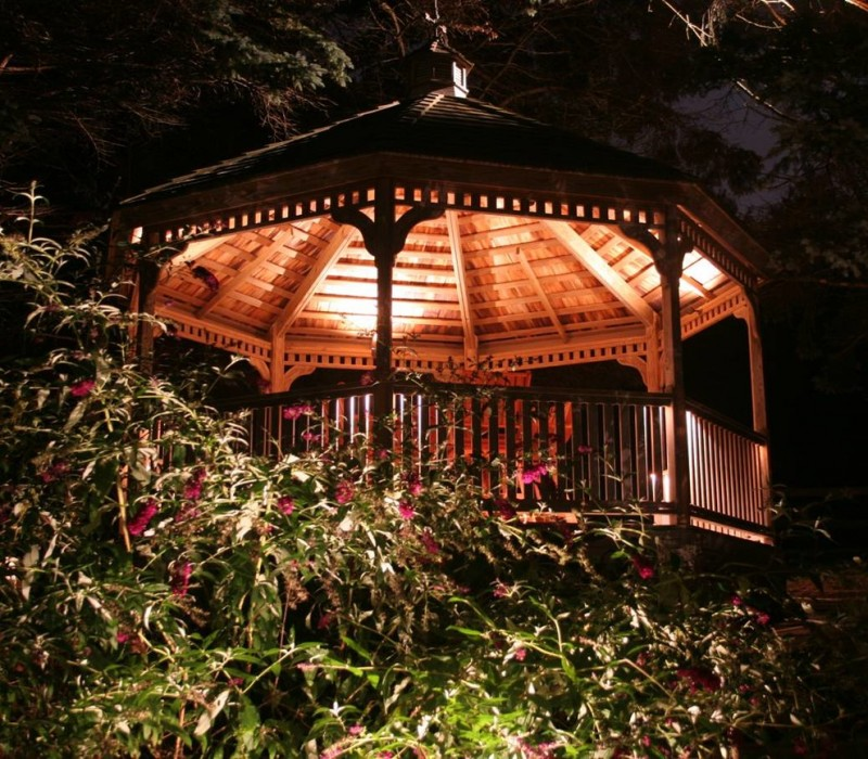 gazebo with vaulted wooden ceiling with sconces