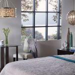 hanging lights in bedroom glass top round table chairs wood sidetable window white bedding pillows modern design