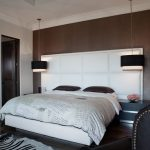 hanging lights in bedroom headboard double bed carpet hardwood floors sidetable chair wood wall contemporary design