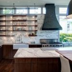 hanging shelves from ceiling marble countertop stainless steel appliances sliding panels sink white backsplash island pendant hood contemporary design