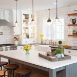 hanging shelves from ceiling subway tile backsplash kitchen island white cabinets hood lights hardwood floor stools farmhouse design
