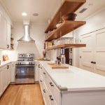 hanging shelves from the ceiling beautiful floor white countertop island ceiling light stove wall cabinets transitional kitchen