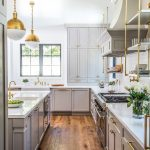 hanging shelves from the ceiling wood floor stove flowers cabinets cool hanging lamps beautiful countertop faucets sink transitional kitchen