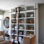 home library shelving baseboards bookcase built in shelves ceiling lighting ladder adjustable ladder postition reading seats window bench