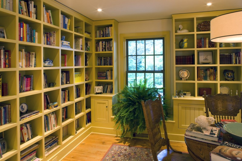 home library shelving green library traditional vintage table and chairs glass window silk plants direct boston fern bush colorful rug reading lamp