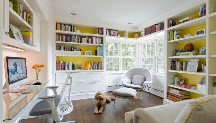 home library shelving grey white Saarinen large womb chair square room glass table small ottoman corner glass window
