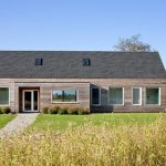 houses that look like barns windows door roof plants grass trees transitional exterior