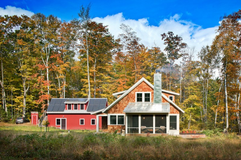houses that look like barns windows red wall grass trees door car roof farmhouse exterior