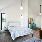 Industrial Bedroom Idea With Colorful & Square Shaped Motifs Clean White Walls Thin Black Framed Windows Shabby Woodboard Floors Classic Pendant Lamps