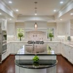 kitchen cabinets clearance brown floor shiny island windows ceiling lights fridge faucets sinks traditional room