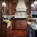 kitchen cabinets clearance brown floor wall cabinet pendant lights flowers fruits island countertops traditional room