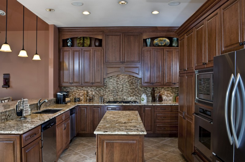 kitchen cabinets clearance hanging lamps brown cabinet island faucet sink countertops ceiling lights traditional room