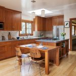 Kitchen Cabinets Clearance Light Coloured Floor Chairs Table Island Window Hanging Lamps Flowers Craftsman Room