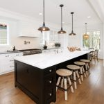 Kitchen Island With Seating For 4 White Countertop Shaker Cabinets Stool Hardwood Floors Pendants Sink Chairs Round Window Beach Style