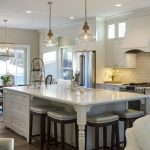 large kitchen islands with seating and storage chairs cabinets chandelier ceiling lights table stools fridge transitional room
