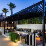 Large Transitional Patio With Black Finished Pergola Modern Couch With Colorful Accent Pillows Outdoor Minibar