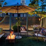 lattice fence designs sofa armchair plant pots deck table flowers sunbrella traditional design