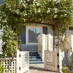 lattice fence designs stone steps rose top stairs grey walls window beach style