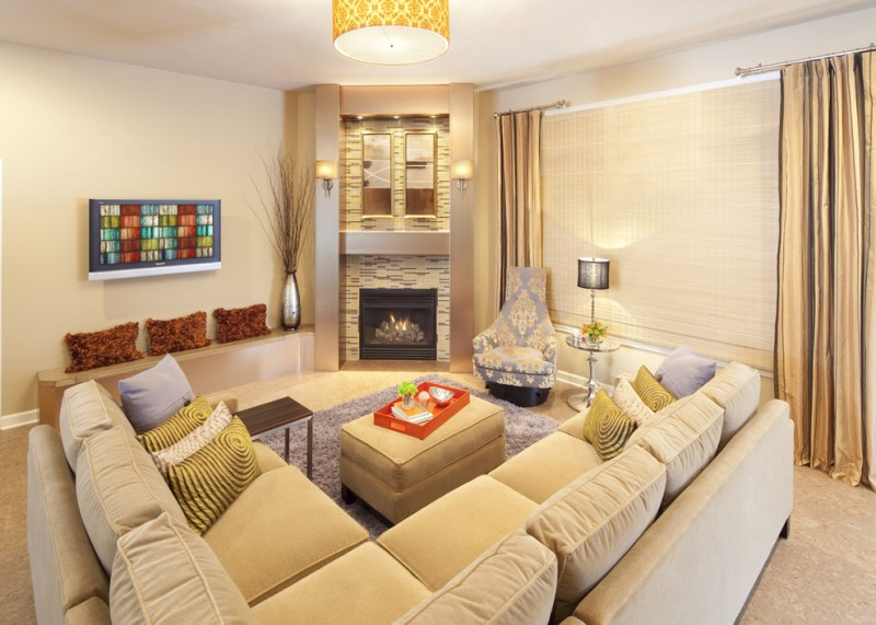 living room with sectional sofa pillows curtains ottoman table chair fireplace wall tv cool lamps contemporary style