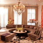 living rooms with sectionals round sofa pillows plant chandelier curtains contemporary living room