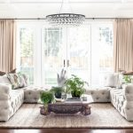 living spaces couches chandelier carpet hardwood floors coffee table decorations window wall curtains traditional design