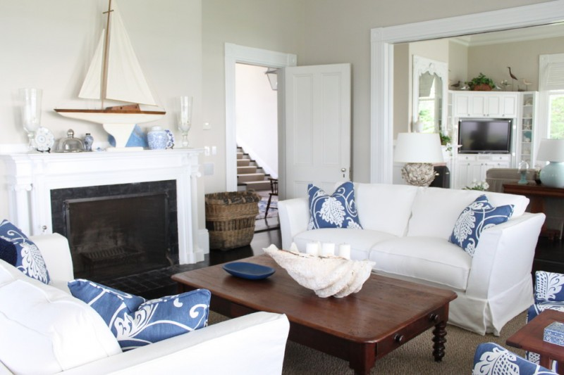 living spaces couches low table pillows tv stairs white door decorations lamps storage item beautiful traditional room
