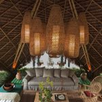 Mat Roof Gazebo With Wooden Floor, Wooden Coffee Table, Grey Sofa, Wooden Chairs, Bamboo Covered Hanging Lamp