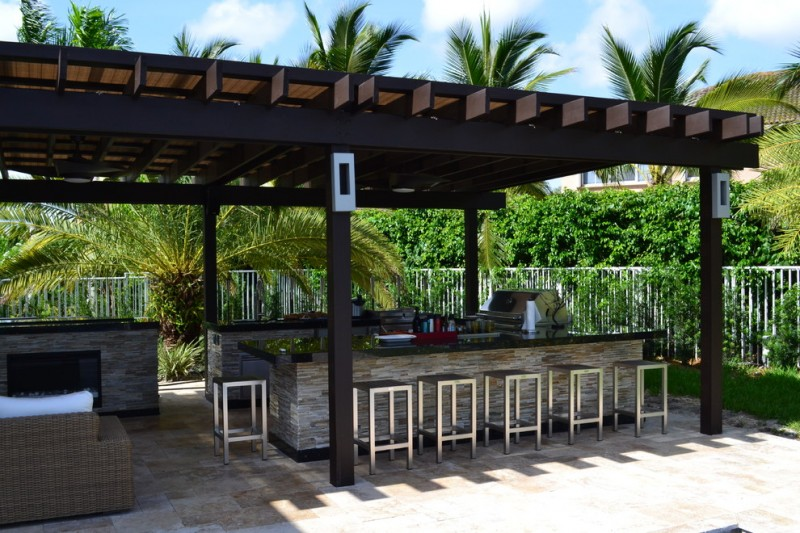 mediterranean patio and outdoor kitchen with black finished pergola