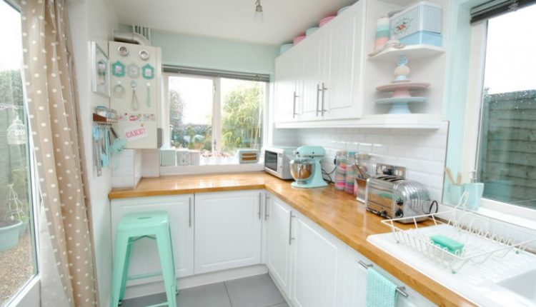 mini kitchen units curtain windows wall cabinets shelves stool rack oven lamps beach style room