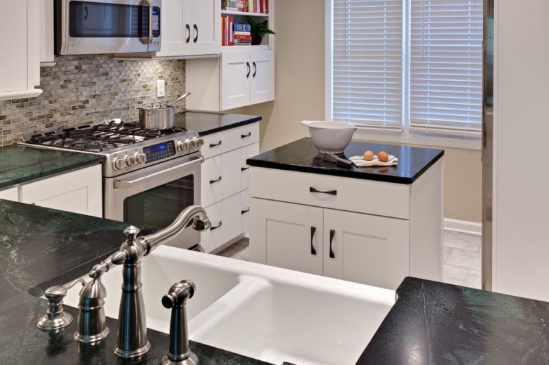 mini kitchen units dark countertop faucet sink stove oven wall cabinets shelf island window books traditional room